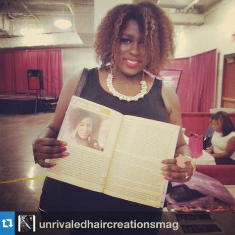 Holding a copy of Unrivaled Hair Creations Magazine that I was featured in.